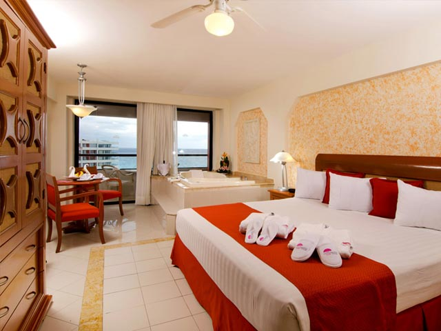 "ROOMS STANDARD ROOMS Guaranteed ocean view. 1 King'size or 2 double beds, satellite TV, iron and ironing board, hair dryer, coffee maker, security box, radio alarm clock, air conditioning and phone with voice message box. CROWN CLUB ROOMS Exclusive for adults, air conditioning and ceiling fan, King size bed, satellite TV and hair dryer. Jacuzzi, mini-CD stereo, coffee maker, slippers and bathrobe. Sparkling wine, fruit basket and floral arrangement in the room upon your arrival. Cocktail with hors-d'oeuvres in the afternoon and gourmet breakfast in the morning. One romantic dinner per stay and one meal at the Cancun Queen Cruise boat (only Tuesday, limited spaces). Reservation required FAMILY ROOMS Family rooms in Crown Tower: King-size bed with semiindependent area for children that includes their own TV, triple bunk bed and box bed. Ideal for families of 2 adults and 3 kids. Family rooms in Paradise Tower: Duplex style accommodation that includes a main room with king size bed and lower floor with double bed and triple bunk bed with box bed. Two full baths. Excellent for families of up to 7 people. Both equipped with the same amenities as Standard rooms HONEYMOON SUITES Beautiful and spacious oceanfront suite with separate living area, 1 King size bed, large terrace with balcony and Jacuzzi. Installations for kids BABY PARADISE: for children of 18 months to 3 years of age. Open from 9:00 am. To 5:00 pm. And from 6:00 pm to 10:00 pm. Except Saturdays, from 9:00 am. till 5:00 pm. KIDS PARADISE: Aqua Park for children between 4 and 12 years of age, daily activities. Open from 9:00am. To 5:00 pm. and from 6:00 pm to 10:00 pm. Except Saturdays, from 9:00 am. till 5:00 pm WATER PARK: Enjoy hours of entertainment for the entire family with water slides, zip line, rappelling wall, beach volleyball and mini soccer. From 9:00 am. to 5:00 pm. Subject to change for activities. Services Weddings Gymnasium Tennis court Volleyball Basketball Mini golf Hospitality suite Meeting Rooms Parking Daily transportation to Aquaworld for non-motorized sports included Golf: unlimited green fees in Pok ta Pok Golf Club Services with extra cost Beauty salon Boutiques / Tobacco shop Handicraft shop Jewelry store Phone & Fax service Car rental Travel agency Wi-Fi Internet access Business center Spa Medical service Baby sitting service RESTAURANTS LA PALAPA International buffet style restaurant offering breakfast, lunch and dinner. Open daily from 7:00 am. To 9:30 pm. Dress code: Casual beach. LOS GALLOS Mexican specialties – Dinner service ""à la carte"" with live music. Dress code: Casual resort. LA PIAZZA Authentic Italian flavor. Dinner with ""à la carte"" service. Dress code: Casual resort. FUJIYAMA Sushi style Japanese restaurant – ""À la carte service"" Open from 12:00pm. to 5:00 pm. Dress code: casual beach SANS SOUÇIS French cuisine with ""à la carte"" service adults only. Dress code: Elegant resort. WAYNE'S BOOTS Country style restaurant enlivened with a mechanical bull and serving tantalizing meat cuts. À la carte service. Dress code: Casual resort. FISHERMAN'S Fish and seafood – Dinner with ""à la carte"" service. Dress code: Casual resort All restaurants require reservations except for La Palapa and Fujiyama. 24 HR. FOOD AND BEVERAGE SERVICE Daily tea time from 4:00 pm to 5:30 pm. 24 hr. room service. SNACK BAR: Tutuch: Pool area from 11:00 am. To 5:00 pm. Midway Stop: Open from 9:00 pm. to 6:00 am. DRESS CODES Casual beach: Shorts, pants, skirts, tennis shoes or beach sandals. Ladies must cover their swimsuits and men must cover their chest at all times. Casual resort: Sports or casual shoes or formal sandals, shirt with sleeves, clean style bermuda short or pants. Access will be refused if wearing sleeveless shirt and beach sandals. Elegant resort: Men must wear long pants and collar shirts. Shoes or sandals (closed). Women: Blouses, skirts, dress pants, shoes or sandals. NOCTURNAL ENTERTAINMENT Nightly shows: Grease, Mexican folklore, Las Vegas & Casino, Mamma Mia, Circus Night, Fantasia… and much more! Program subject to change. CLUB NITRO: Activities and contests for kids and teenagers till 11:00 pm. through Kids Paradise and discotheque for teenagers and adults only from 11:00 pm on. BARS TRAFALGAR: Disco & Pub Marine-English style LOBBY BAR: Live music CLUB CARIBE: Pool & swim-up bar LA CONCHA: In-pool bar LAS BRISAS: In-pool bar COLLAGE BAR AND JETIX: Pool, ping pong, movie room, video games, foosball and non-alcoholic cocktails. POOLS Las Brisas: Main beach-front pool with music and activities La Concha: Beach front pool Coco Loco: Semi-roofed pool Club Caribe: Exclusively for adults Kids Paradise: Aqua park for smaller children Aquatic park: For the entire family"